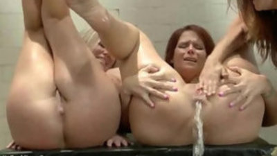 Latex women, anal fisting, stretching and enemas