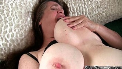 Busty grandma has to take care of her throbbing hard clit