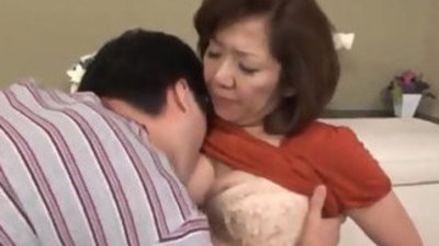 Japanese mature kisses her boy